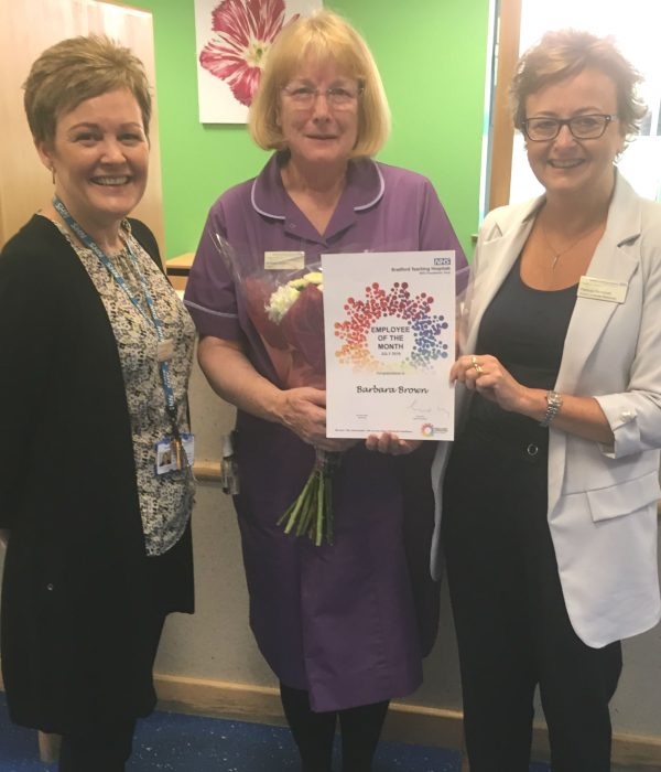 Sister Barbara Brown (centre) receives her award from Pat Campbell, head of HR (right), and Jo Young, head of planned access