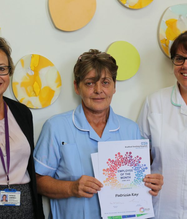 Patricia Kay (centre) receives her award from Pat Campbell (director of HR (left) and Debbie Grimes (specialist speech and language therapist