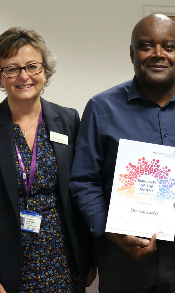 Employee of the Month David Sado receives his award from Pat Campbell, Director of HR