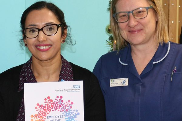 Shabana Yasin receives the November Employee of the Month Award from Paediatrics Matron Ruth Tolley