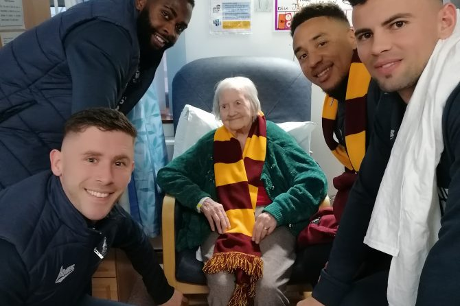 City players prove a hit with 104-year-old May during Christmas visit