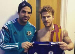 Billy Clarke and Cesc Fabregas following the Bantams' victor over Chelsea in the FA Cup. Billy later raffled off the shirt to raise funds for Bradford Hospitals' Charity.