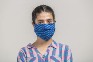 Portrait of a girl covered with homemade mask for prevention during covid-19 pandemic
